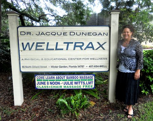 Julie Witts in front of sign